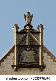 Gable of the people's house with the city's coat of arms and an owl. Stone chronicle of Saint Petersburg.