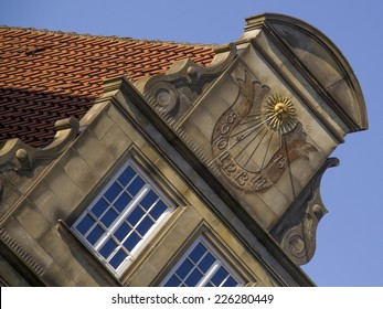 Gable with sun clock at historical, restored facade of medieval building at square Rathaushausplatz in Hanseatic city Bremen. Gable was restored in 1960th.