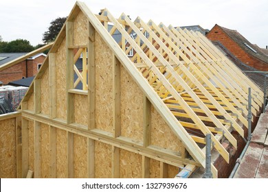 Gable and wooden roof trusses to a timber frame house under construction
