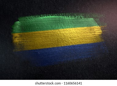 Gabon Flag Made of Metallic Brush Paint on Grunge Dark Wall