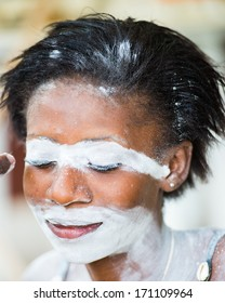 GABON - MARCH 6, 2013: Portrait of an unidentified Gabonese girl with the white paint on her face in Gabon, Mar 6, 2013. White paint symbolizes connection with ancestores.