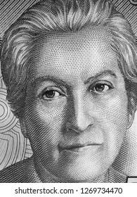 Gabriela Mistral portrait on Chile 5000 peso banknote close up. Chilean poet, 1945 Literature Nobel Prize winner. Black and white.