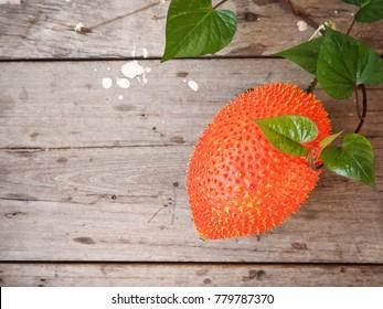 Gac fruit on wood background