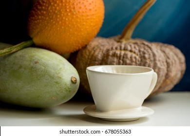Gac fruit, Pumpkin,coffee cup and Winter Melon with still life.