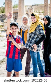 GADARA, JORDAN - MAY 2, 2014: Unidentified tourists in the ancient town of Gadara, Jordan. By the third century BC the Gadara town was of some cultural importance.