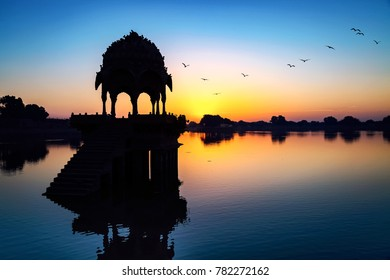 Gadi Sagar lake (Gadisar) at Jaisalmer, Rajasthan with ancient temple at dawn.