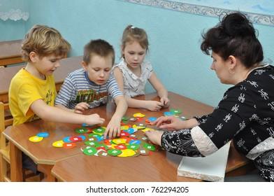 Gadjievo, Russia - April 21, 2011: Children are engaged with training aids in kindergarten