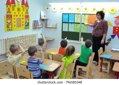 Gadjievo, Russia - January 9, 2011:  The teacher deals with the children in the kindergarten
