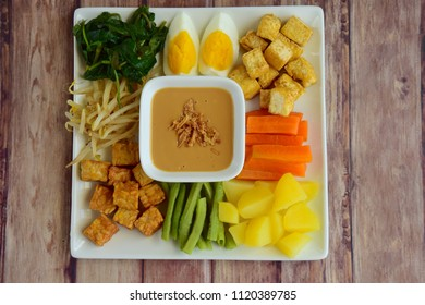 Gado-gado, Indonesian salad with peanut sauce on wooden background