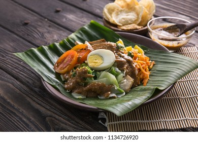 gado-gado. traditional indonesian food. rice cake, egg and vegetable with peanut sauce