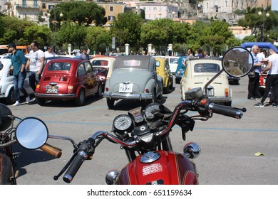 GAETA, ITALY - 05/14/2017: Point of view from a a shiny Guzzi motorcycle at the local Fiat 500 gathering.