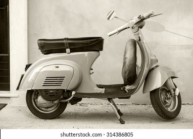 Gaeta, Italy - August 19, 2015: Classic Vespa scooter stands parked near the wall