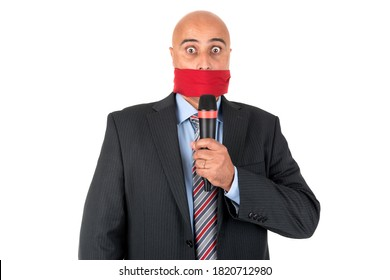 Gagged businessman with a microphone isolated in white