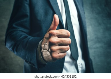 Gaining bosses approval, businessperson gesturing thumb up for endorsing or approving employees work, concept of success and good work in business.