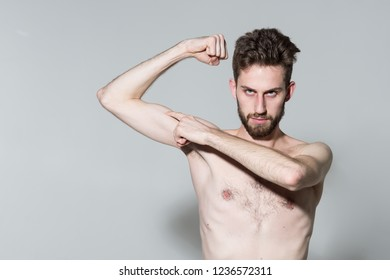 Gaining some muscles. Slim man do sport training. Skinny young man flex arm. Stimulating muscle growth with anabolic steroids. Man increases muscle strength with anabolic hormone. Sport and fitness.