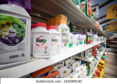 Gaithersburg, MD / USA - June 10, 2019: A plant nursery and gardening store sells RoundUp, a weed killer that contains glyphosate, a systemic herbicide and crop desiccant.