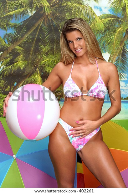 gal with beach ball on a beach background