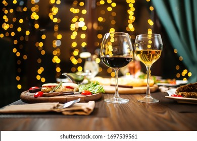 Gala dinner with a glass of red wine, laid table, side view, horizontal