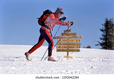 GALA, NORWAY- FEBRUARY 07,2017: Norway a single langlaufer tracking through the snowfields, near a signpost