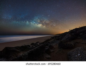 The galactic core of the milky way sets over New Smyrna Beach, Florida.