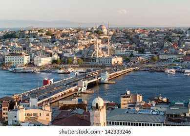 Galata Bridge and the historical centre of Istanbul, Turkey. Galata Bridge over the Golden Horn is one of the main travel attractions. Aerial panoramic view of the city with Galata Bridge in summer.