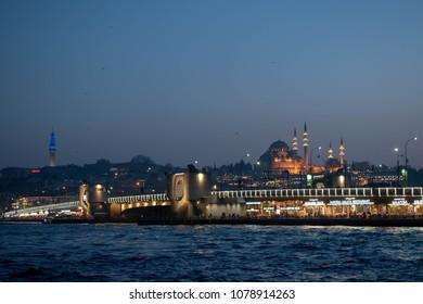 Galata Bridge on Golden Horn, Suleymaniye Mosque in background, April 17, 2018, Istanbul/Turkey