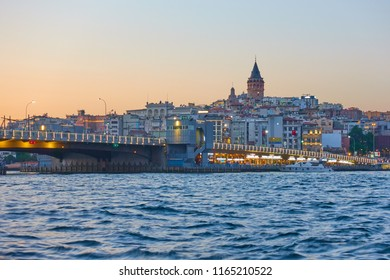 The Galata Bridge over Golden Horn in Istanbul at night, Turkey