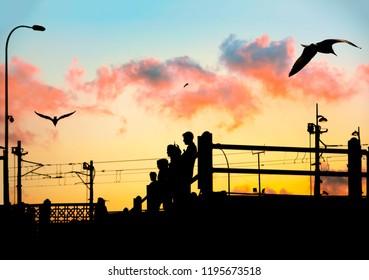 Galata bridge and people at sunset