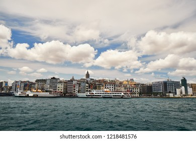 Galata tower Beyoglu district travel destination famous historical and cultural heritage cityscape panorama sight from Bosphorus. Beautiful blue sky skyline tourism buildings view. Istanbul Turkey