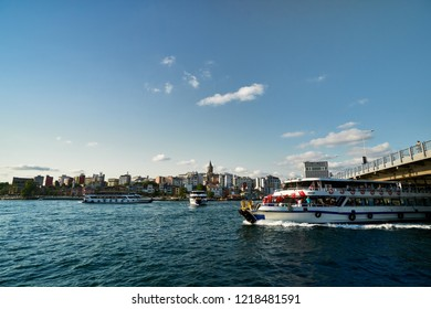 Galata tower Beyoglu district travel destination and Golden Horn bridge famous historical and cultural heritage cityscape panorama sight from Bosphorus. Blue sky tourism buildings view Istanbul Turkey