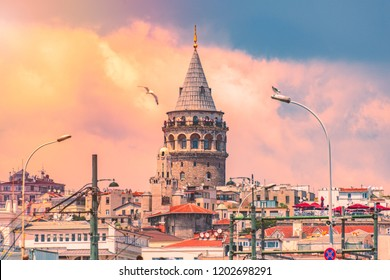 Galata Tower, Christea Turris, medieval stone tower in the Galata/Karaköy quarter of Istanbul, Turkey. Sunset cloudy sky in background.
