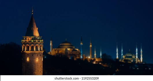 Galata Tower at night with Hagia Sophia and The Blue Mosque in Istanbul