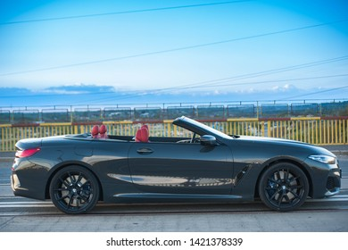 Galati, Romania - April 28, 2019: BMW 850i G14 xDrive Steptronic side view on a road with a blue sky. Wallpaper