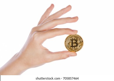 Galati, Romania - January 16, 2017: Studio shot of Young girl hand holding bitcoin on white background