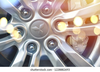 Galati, Romania - September 2, 2017: Mitsubishi wheel logo displayed in an automobile show. Mitsubishi is an automobiles manufacturer