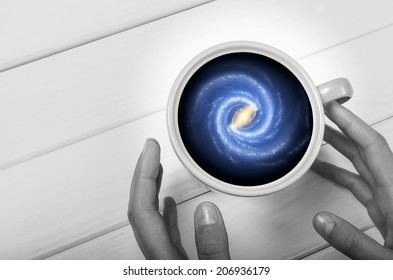Galaxy in the cup. Image contains elements by NASA.