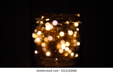 A galaxy in a jar. LED lights in a glass jar off focus bokeh abstract. Mason jar lights abstract. Intentionally shot off focus.