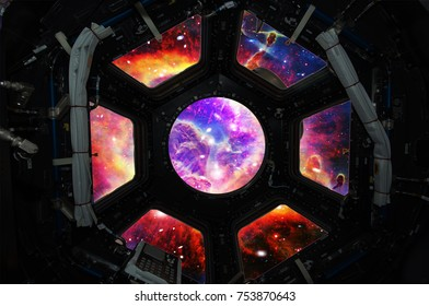 Galaxy and nebula from the window of a spaceship. Deep space. Elements of this image furnished by NASA.