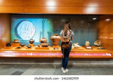 Galdar, Spain - March 2, 2019: Woman admiring the Interior of museum and Archaeological park, Cueva Pintada, in Galdar Gran Canaria, Spain .