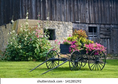 Galena Barn An old weathered barn on the outskirts of Galena forms  a backdrop for an antique wagon filled with flowers.Jo Daviess County, IL.
