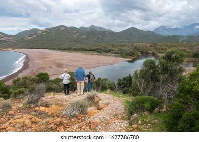 GALERIA, HAUTE-CORSE/FRANCE - NOVEMBER 4, 2018: Tourists near the confluence of the river Du Fango into the sea Corsica