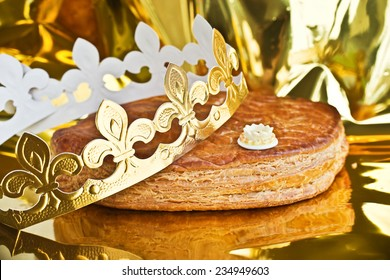 Galette des rois, french epiphany kingcake with a golden crown