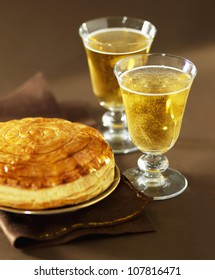 Galette des rois and glasses of cider