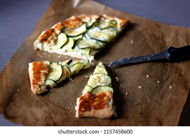 Galette made with courgette and cheese (ricotta, mozzarella, parmesan). Selective focus.