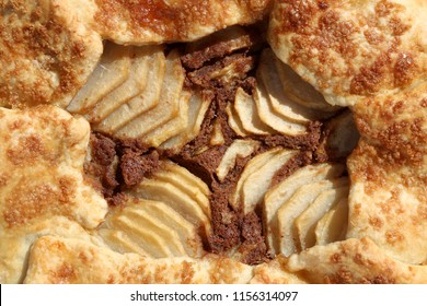 Galette with pear and almond filling. Top view, close-up.