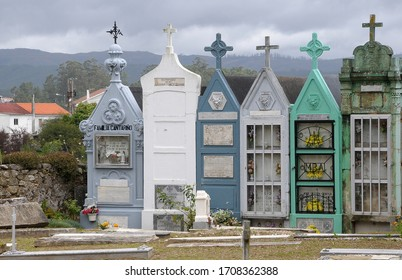 Galicia, Spain - December 28, 2009: Detail of graves in a Catholic cemetery next to the church of a Galician village