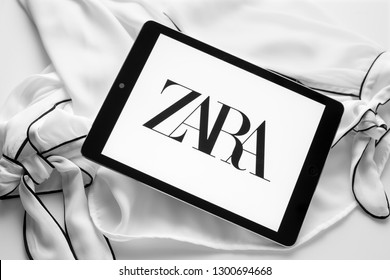 Galicia, Spain; january 30 2019: Zara new logo. Tablet with new curvy typeface logo on black and white blouse