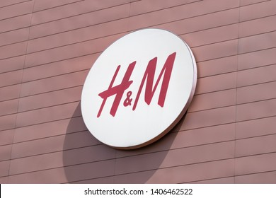 Galicia, Spain; May 23, 2019: HM sign on shopping mall facade. Fashion consumerism
