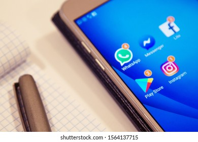 galicia, spain november 12, 2019: app icons on mobile phone, facebook, instagram, whatsapp, messenger and play store