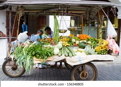 GALLE - MARCH 15: Vendor selling fresh vegetables and fruits, 15 March 2013 in Galle, Sri Lanka. Many people buy fresh food on the street rather than at shops.
